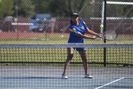 Wi-Hi's Th'aliya Goslee, plays number 1 singles against James M. Bennett High School on Tuesday, April 23, 2019.