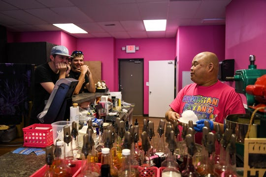 Bryan Horikami chats with customers, Hunter and Tyler Massey, in his Hawaiian store in Salisbury on Tuesday, April 23, 2019. The two said they come in for shave ice three to four times a week.