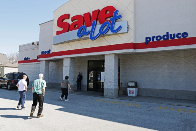 People enter Save-A-Lot store, Wednesday, April 24, 2019, in Sheboygan, Wis. The store announced it will close as soon as inventory is sold.