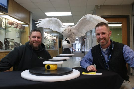 Taxidermist Jeff Herrick and science teacher Chris Hendrikse with the snowy owl Herrick preserved last year. Herrick works at Birdzone Taxidermy in Neenah. He preserved the bird for free for the school. He also made the stand the bird and duck (also donated) is perched on. The snowy owl now lives at the high school campus of Sheboygan Christian.