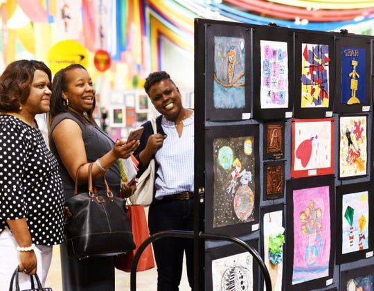 Chaundra Elias (center) sees her daughters art work with friends Pam Graham (right) and Myra Robinson (left) at ArtBreak Wednesday afternoon, April 24, 2019 at the Shreveport Convention Center.