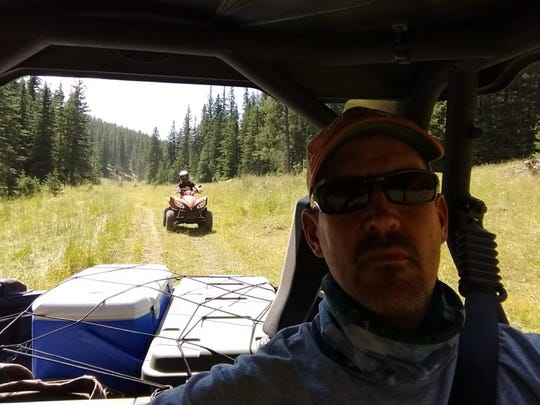 Scott Wittrock of Hartford, president of the South Dakota ATV/UTV Association, took this selfie while driving a Utility Terrain Vehicle as his son, Blaine, followed him on an ATV during the 2017 Soggy Bottom Rally that attracted enthusiasts to trails near Deerfield Lake in the Black Hills. Research shows that riding ATVs and UTVs off-road is safer than driving them on paved or unpaved roadways.