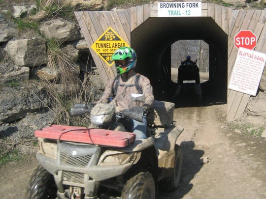 Scott Wittrock, president of the South Dakota ATV/UTV Association, navigates a remote section of West Virginia on his ATV during an organized ride there. Data show that trail riding is less deadly than driving the all-terrain vehicles on roadways.
