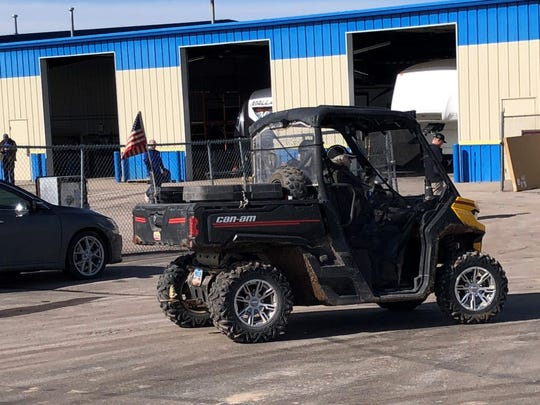 A man and woman took their Utility Terrain Vehicle on a ride through a Summerset neighborhood and business park on a recent day. Recent studies show that ATVs and UTVs are designed specifically for off-road use and are less safe on paved and unpaved roads.