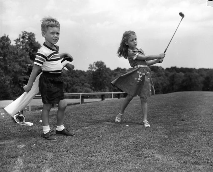 Cindy Lowe, six-year old daughter of Dr. And Mrs. H.A. Lowe Jr., practiced her swing with Blair Hawkins Jr. at Hickory Hills County Club. Published in the News & Leader on July 13, 1952.