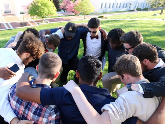 Mary Baldwin men's soccer players gather during a protest Sunday afternoon. The players were unhappy that their coach, Robert Rose, will not be returning next season.