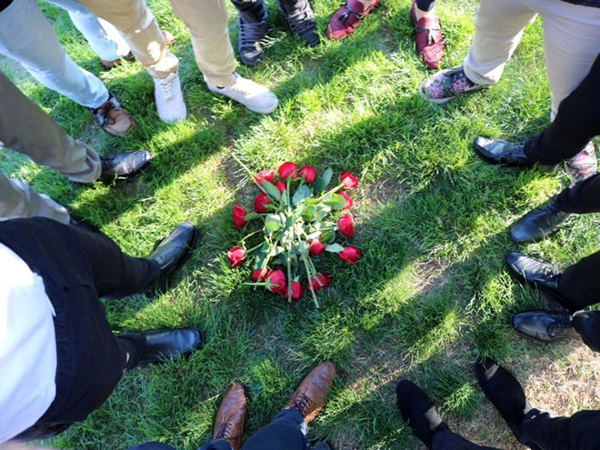 Mary Baldwin men's soccer players placed roses on the ground in a protest after word that their coach, Robert Rose, would not be returning next season.