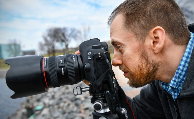 Photographer David Barthel looks through the viewfinder of his camera Wednesday, April 24, in St. Cloud. Barthel is releasing a book of landscape photography focused on Duluth and the North Shore.