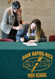 Soleil Newland signs her letter of intent to play volleyball at the University of Northwestern during the Sauk Rapids Senior Signing Day ceremony Wednesday, April 24, at Sauk Rapids-Rice High School.