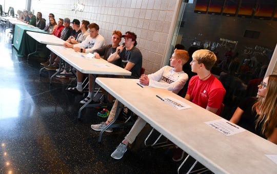 Athletes line up to introduce themselves during the Sauk Rapids Senior Signing Day ceremony Wednesday, April 24, at Sauk Rapids-Rice High School.