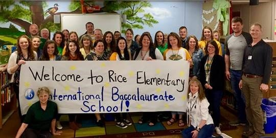 Rice Elementary School staff celebrate becoming authorized as an International Baccalaureate Primary Years Programme school April 23, 2019.