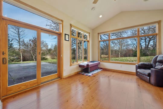 Windows surround the sunroom and provide magnificent views of the property.