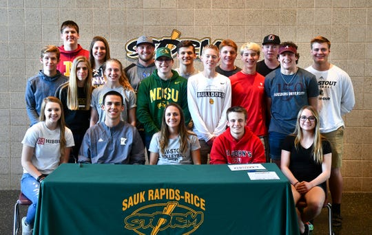 Seniors gather for a group photograph during the Sauk Rapids Senior Signing Day ceremony Wednesday, April 24, at Sauk Rapids-Rice High School.