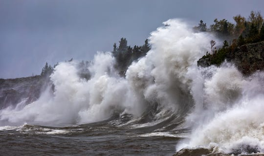 "David Barthel's photo ""Souls of Superior"" captures waves crashing against a rocky shore in Crystal Bay at Tettegouche State Park on the North Shore of Lake Superior. The photo was taken for Barthel's book, ""North Shore-Duluth: A Photo Tour of Northeastern Minnesota."""