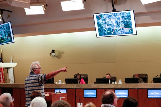 Sean McGlynn speaks out against the North Florida resiliency connection transmission project during a City Commission meeting at City Hall Wednesday, April 24, 2019.