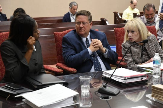 Melody Hadley, advocate for the Florida Commission on Ethics, left, Keith Powell, senior investigator for the Florida Commission on Ethics, and Elizabeth Miller, chief advocate for the Florida Commission on Ethics discuss the ethics case against former Mayor Andrew Gillum Wednesday, April 24, 2019.