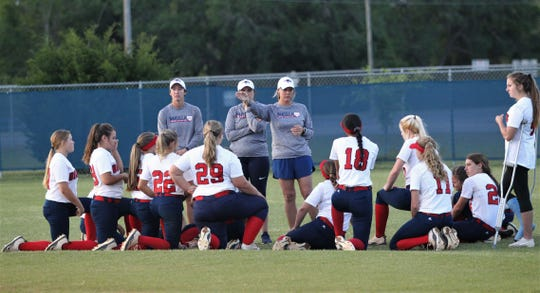 Wakulla softball coach Sally Wheeler talks to her team after Wakulla beat Franklin County 9-0 on April 23, 2019.