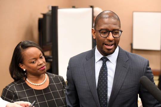 Former Mayor Andrew Gillum, right, and his wife R. Jai Gillum addresses the media's question after it was announced that he settled in his case with the Florida Commission on Ethics Wednesday, April 24, 2019.