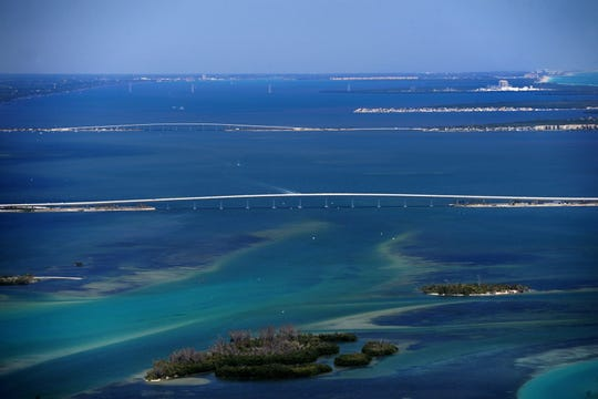 A view of the intracoastal waterway looking north from the St. Lucie Inlet. In view are the Ernest Lyons causeway, Jensen Beach causeway, Nettles Island and the St. Lucie nuclear power plant in St. Lucie County.