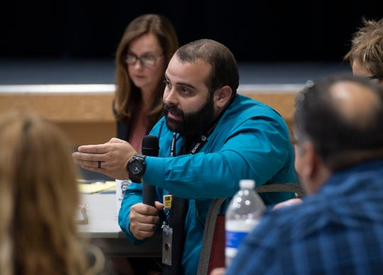 """""""This is affecting every single youth in our county. If we don't put an end to it, we're going to have very highly addicted kids,"""" said Jensen Beach High School assistant principal Anthony Calzadilla, about e-cigarettes, on Wednesday, April 24, 2019, during the quarterly United Way of Martin County Community Conversations event at First United Methodist Church in Stuart. Kim Nash (not pictured), community health advocated for the QuitDoc Foundation, hosted a conversation with concerned parents and representatives from local organizations, including the Martin County School District, Tykes & Teens and the Cherab Foundation."""
