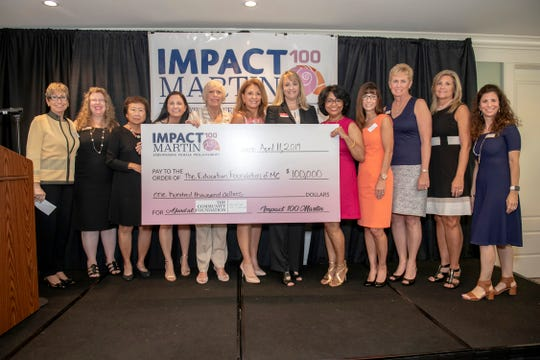 Representatives from Impact 100 Martin's Executive Committee and The Community Foundation Martin-St. Lucie present the Impact Grant to the Education Foundation of Martin County. Pictured are, from left, Ellyn Stevenson, Linda Weiksnar, Nancy Wong, Genevieve George, Rita May Wright, Elaine Matts, Lisa Rhodes of the Education Foundation of Martin County, Arati Hammond, Elizabeth Barbella, Denise Belizar, Cindi Slagter and Tiann Berhoff.