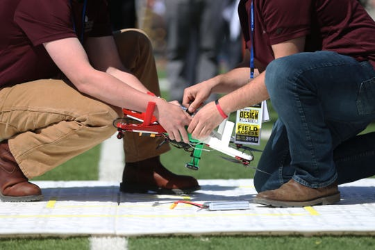 Maryland Eastern Shore students change the battery in their drone on the landing pad during the U.S. Army Drone Design Competition hosted by UTEP Wednesday, April 24, at the Sun Bowl in El Paso.
