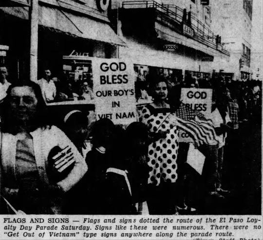 "1967 Loyalty Day Parade - Flags and signs dotted the route of the El Paso Loyalty Day Parade Saturday. Signs like these were numerous. There were no ""Get Out of Vietnam"" type signs anywhere along the parade route."