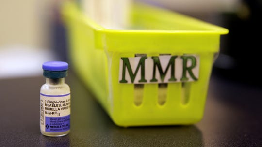 This file photo shows a measles, mumps and rubella vaccine on a countertop at a pediatrics clinic in Greenbrae, Calif.
