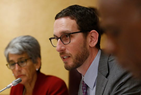 California state Sen. Scott Wiener, D-San Francisco speaks at a Senate Public Safety Committee hearing on Tuesday,  in Sacramento. In back is Sen. Hannah-Beth Jackson, D-Santa Barbara, who represents western Ventura County.
