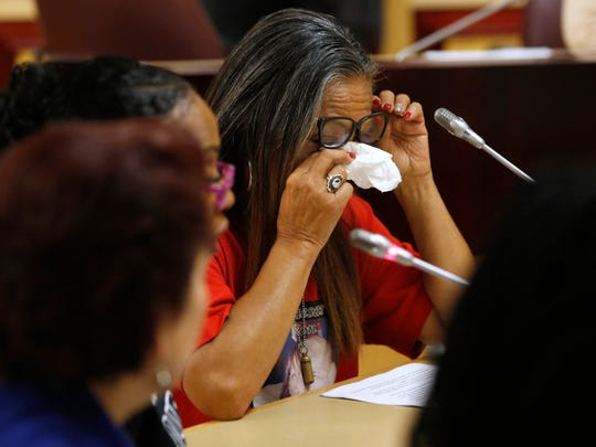 Theresa Smith, right, the mother of Caesar Cruz, who was killed in a confrontation with police, wipes her eyes after testifying against a police-backed law enforcement training bill by state Sen. Anna Caballero, D-Salinas, during a hearing at the Capitol on Tuesday in Sacramento.