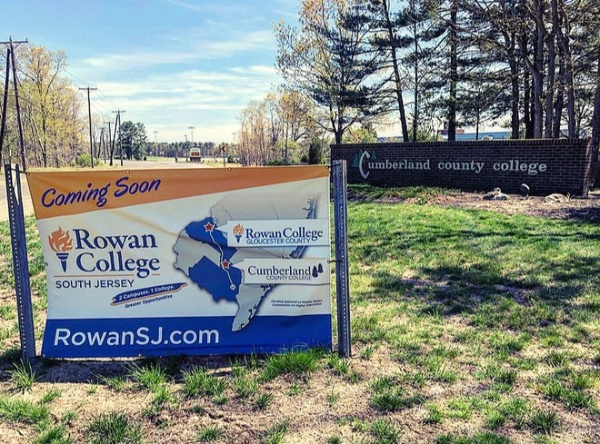 Signs advertising Rowan College of South Jersey stand at the entrances to Cumberland County College.