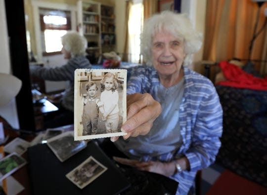 Lois Bohovesky shows a photo of her children Paula and Peter at her Pearl River home April 24, 2019. Paula's killers are up for parole.