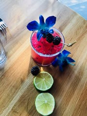 The BlackBerry margarita with Chambord is made with all fresh juices and decorated with an orchid at Mission Taqueria in Pleasantville.