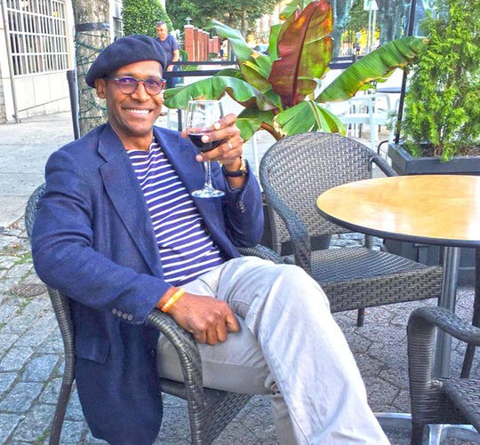 Alvin Clayton, the owner of Alvin & Friends in New Rochelle, on the restaurant's patio.