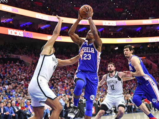 Philadelphia 76ers guard Jimmy Butler (23) shoots over Brooklyn Nets forward Jared Dudley (6) during the second quarter in game five of the first round of the 2019 NBA Playoffs at Wells Fargo Center Tuesday.