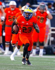 North safety Nasir Adderley of Delaware (23) carries the ball after an interception during the second half of the Senior Bowl college football game, Saturday, Jan. 26, 2019, in Mobile, Ala. (AP Photo/Butch Dill)