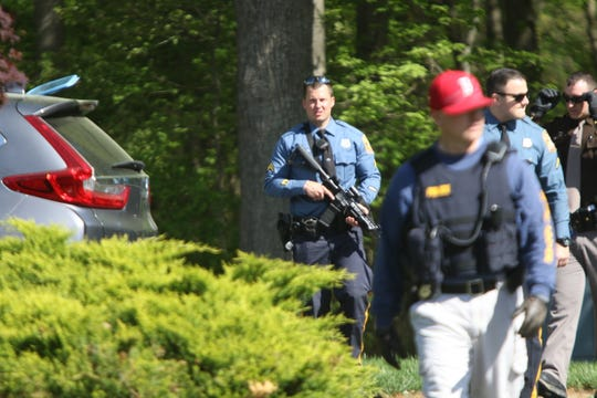 State and New Castle County police search Glasgow neighborhoods for Robert Burke Jr., who state police said assaulted a trooper transporting him to prison Wednesday morning and escaped. He was captured around 10:30 a.m.