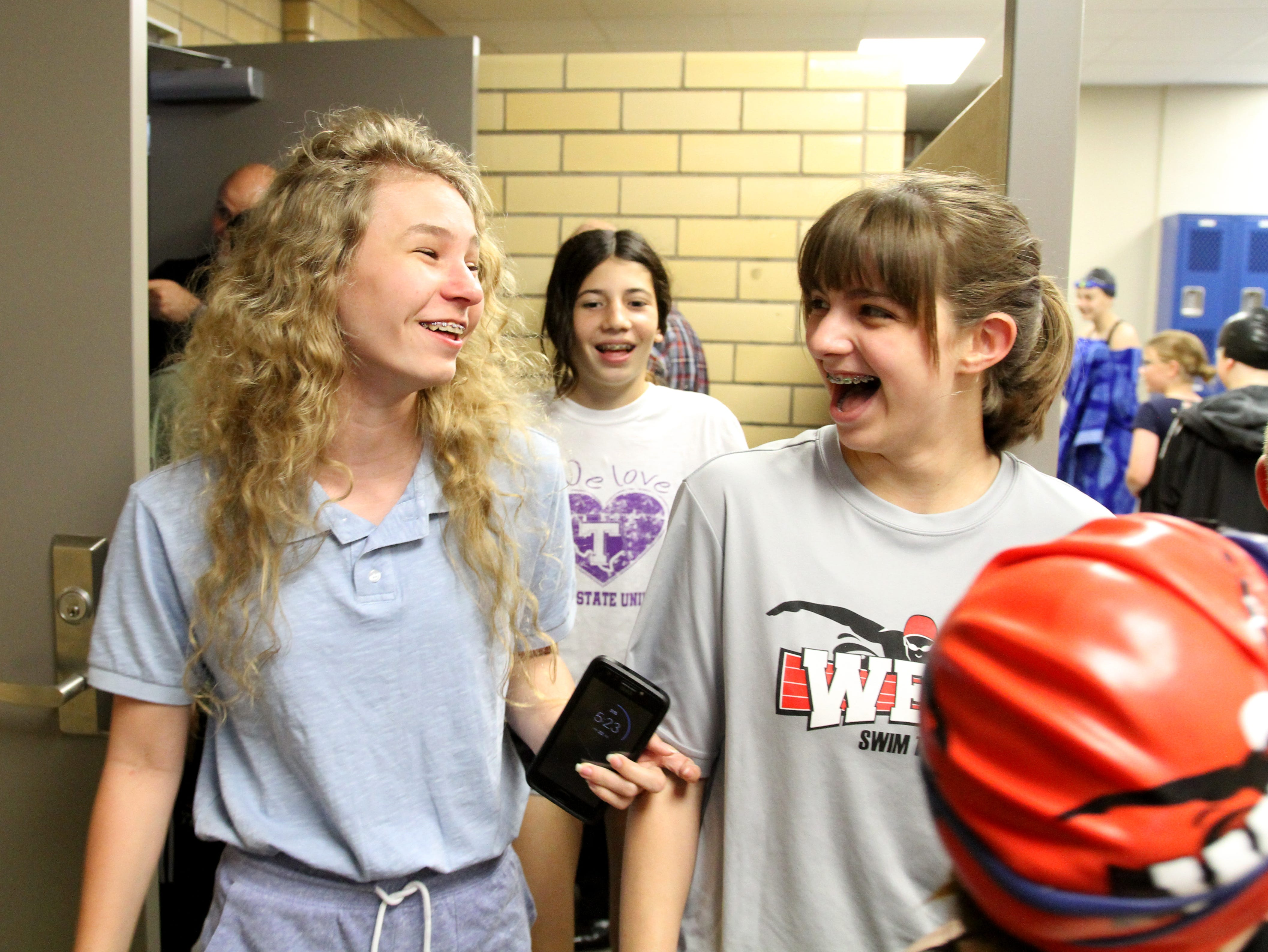 Swimmers and parents take their first look at the renovated locker rooms Tuesday, April 23, 2019, at The Boys & Girls Clubs of Wichita Falls Central Club's locker rooms grand opening.