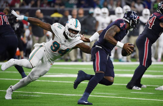 FILE - In this Oct. 25, 2018, file photo, Houston Texans quarterback Deshaun Watson (4) is pressured by Miami Dolphins defensive end Robert Quinn (94) during the second half of an NFL football game in Houston. The Dallas Cowboys have agreed to acquire defensive end Robert Quinn from the Dolphins for a sixth-round draft pick on Thursday, March 28, 2019, in a trade that would bolster the Dallas pass rush while the club works on a long-term contract for DeMarcus Lawrence. (AP Photo/Eric Christian Smith, File)