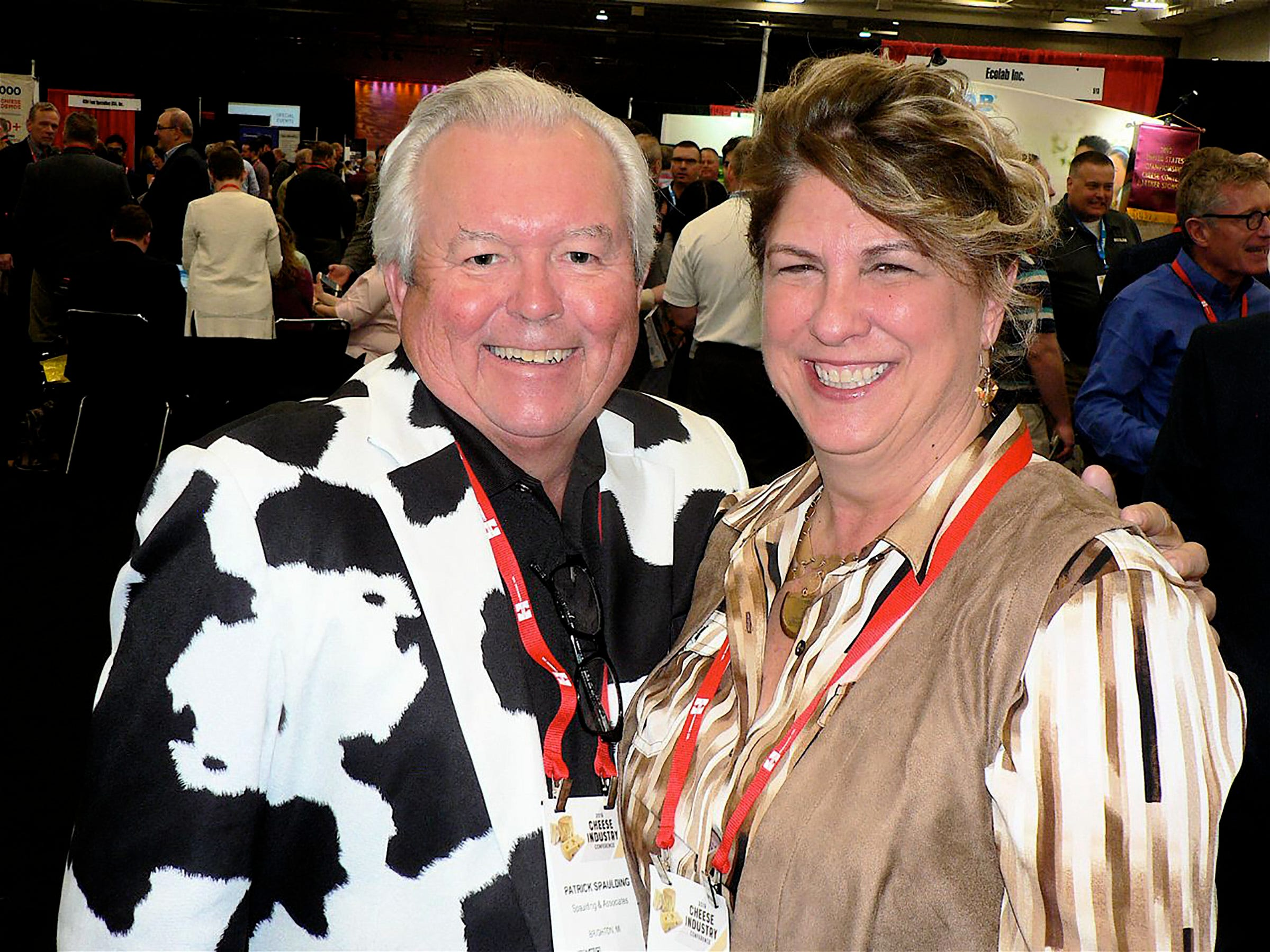 There aren't many Holstein coats being worn, Patrick Spaulding. a cheese buyer has one. He talks with Shirley Knox of Maple Leaf Cheese, Monroe.