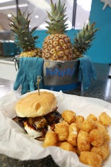 The Hawaiian Delight at Island Burgers and More in the Colony Square Mall. The burger features bacon, Swiss cheese, grilled pineapple and teriyaki sauce and patty on a toasted bun.