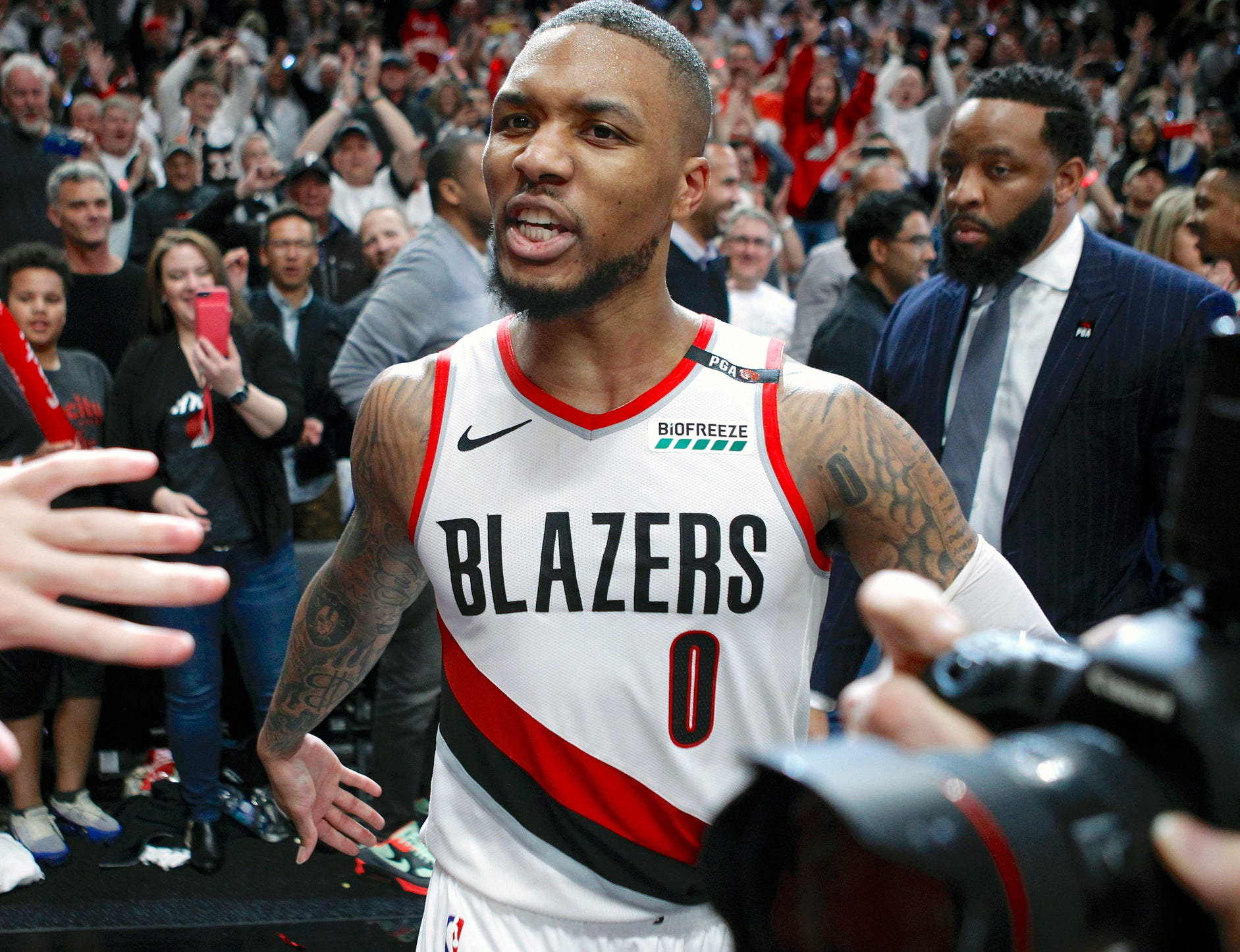 Portland Trail Blazers' Damian Lillard leaves the court after hitting the game-winning 3-pointer to beat the Oklahoma City Thunder.