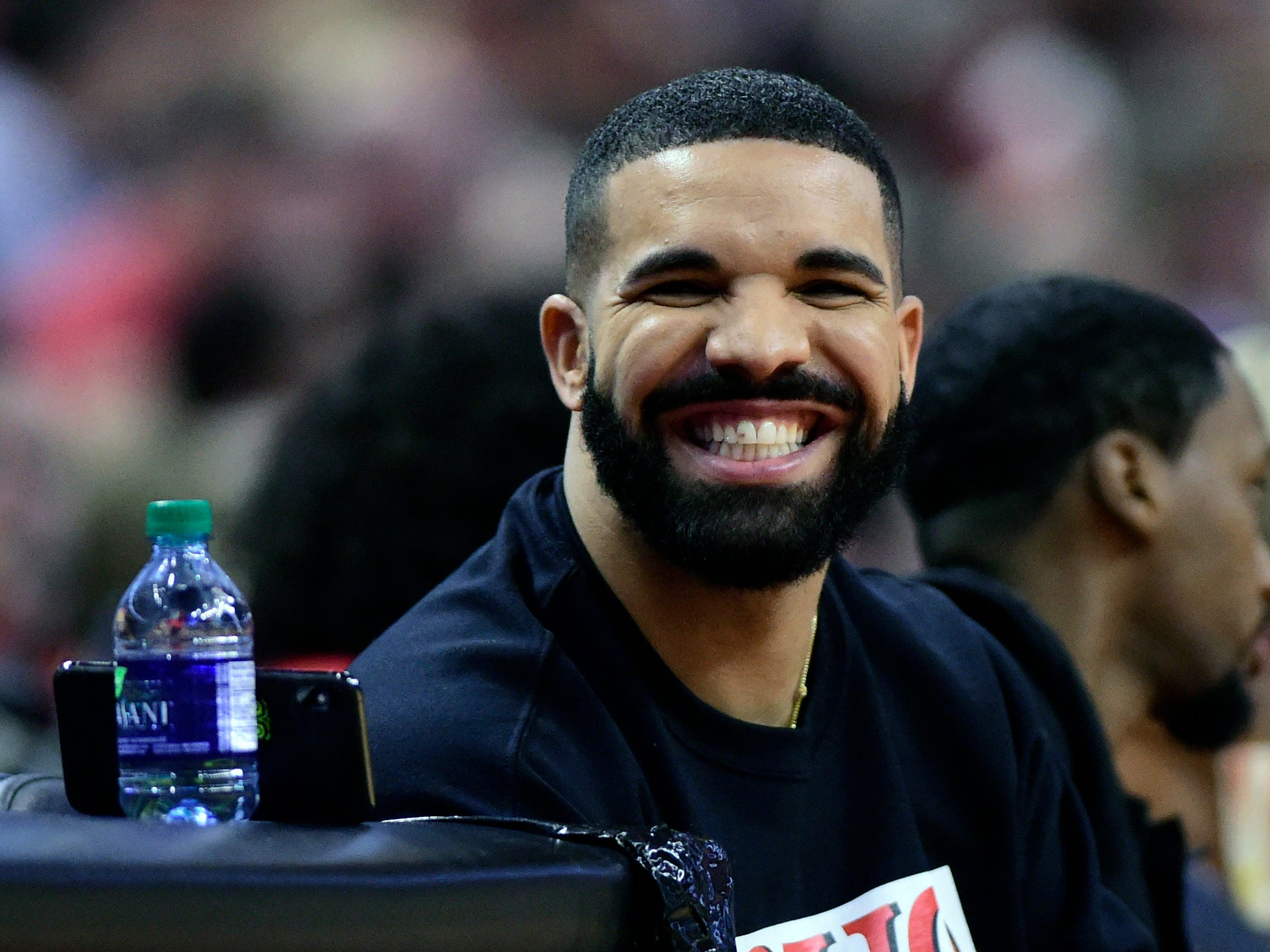 April 23: Drake smiles as he sits courtside during Game 5 between the Raptors and Magic in Toronto.