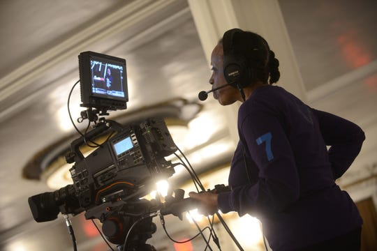 Denise Whitehead, a camera operator, records a live stream of the service for parishioners at First Corinthian Baptist Church in Harlem, New York City.