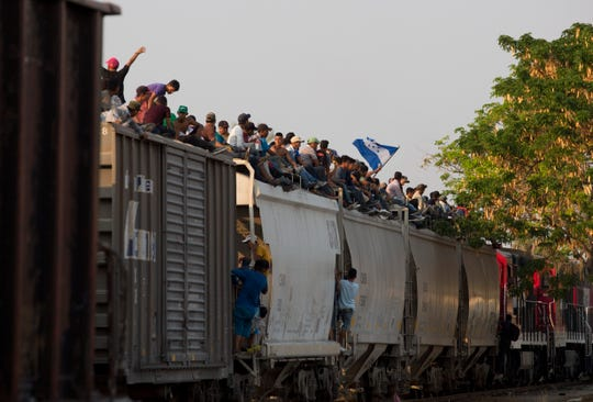 Migrant caravan from Central America riding 'Beast' train in