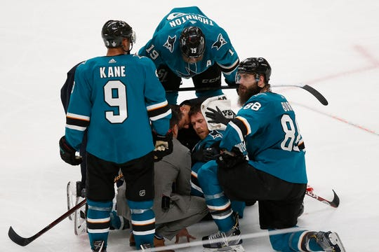 Sharks captain Joe Pavelski receives treatment on the ice after being injured in the third period against the Golden Knights.