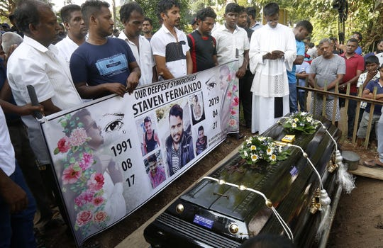 Victims of a  Easter Sunday bombings are buried at Madampe Cemetery in Colombo, Sri Lanka, on April 24, 2019.