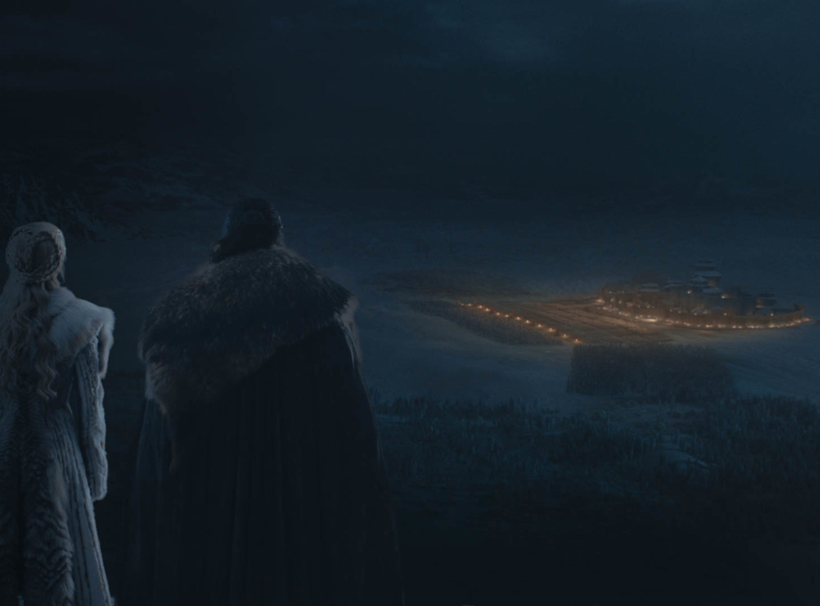 Daenerys Targaryen (Emilia Clarke), left, and Jon Snow (Kit Harington) look at Winterfell from a distance in during Sunday's battle spectacular.