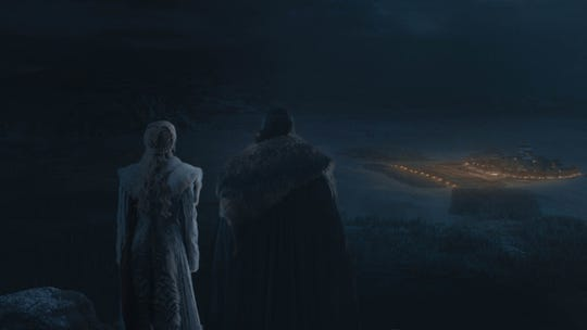 Daenerys Targaryen (Emilia Clarke), left, and Jon Snow (Kit Harington) look at Winterfell from a distance in during Sunday's battle spectacular.
