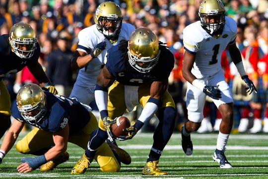 Notre Dame linebacker Jaylon Smith recovers a fumble during the team's game against Georgia Tech in 2015.